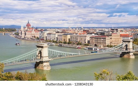 Panoramic cityscape of Budapest with Chain Bridge across Danube River and the Hungarian Parliament in Pest City, Hungary, in autumn.