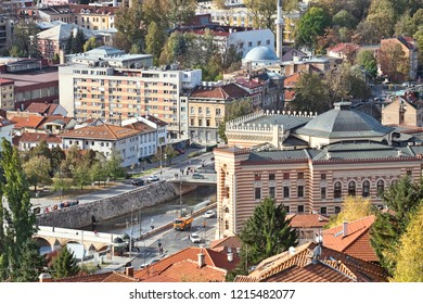 Panoramic cityscape of the historical downtown of Sarajevo, Bosnia and Herzegovina, with famous building of Vijecnica and the bridge across Miljacka river
