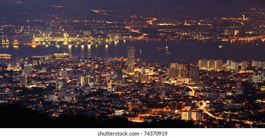 Panoramic cityscape in night with river and tower in Penang, Malaysia, Asia.