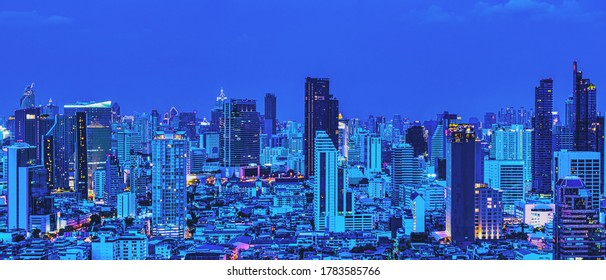 panoramic cityscape scenery of buildings and skyscrapers in business dristrict of Bangkok metropolitant at late evening