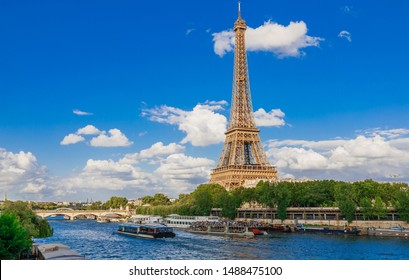 Panoramic cityscape of Seine river, Eiffel Tower in Paris, France, Europe. Eiffel Tower is the symbol of Paris. Famous tourist architecture destination. View of Seine postcard in Paris