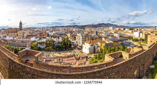 Panoramic cityscape view of historic center of Malaga city, Costa del Sol, Andalusia, Spain. Cathedral of Malaga on the left on background, ruins of Alcazaba theater on the foreground