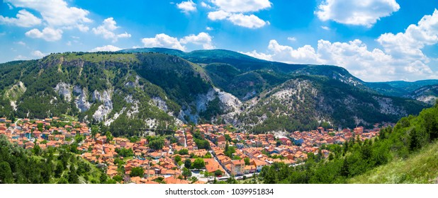 Panoramic cityscape view from historical Kutahya Castle on cloudy blue sky background in Turkey.