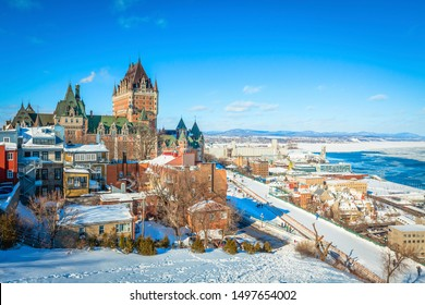 Panoramic cityscape view of Old Quebec City with iconic Chateau Frontenac and Dufferin Terrace against St. Lawrence river in winter, a national historic site of Canada, most famous landmark of Quebec.
