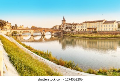 Panoramic cityscape view of Verona old town and bridge over Adige river. Travel destination in Italy concept