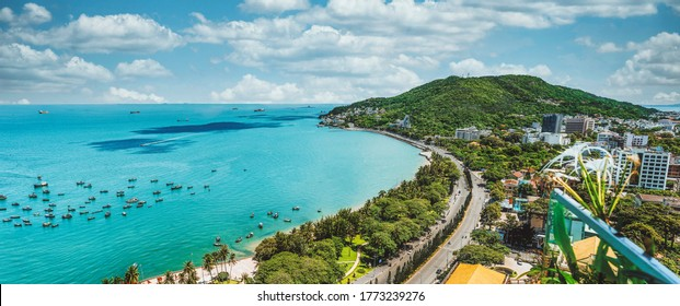 Panoramic coastal Vung Tau view from above, with waves, coastline, streets, coconut trees and Tao Phung mountain in Vietnam