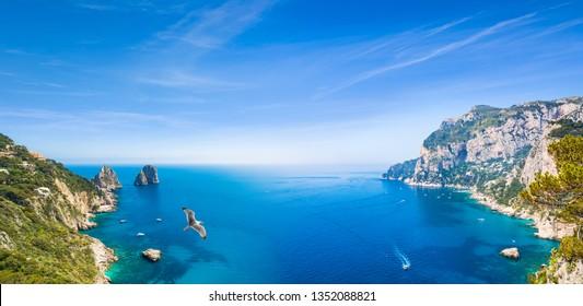 Panoramic collage with famous Faraglioni Rocks, Marina Piccola and Monte Solaro on Capri Island, Italy. Beautiful paradise landscape with azure sea in summer sunny day.