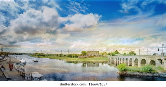 Panoramic colorful  landscape with Shannonbridge on a river Shannon. Boats and quay. Ireland.