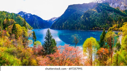 The panoramic colorful scenery of the long lake and forest at Jiuzhaigou national park, world heritage site located in Sichuan Province China