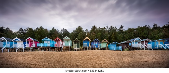 Panoramic of colourful Beach Huts on the beach at Wells-Next-The-Sea, Norfolk, England taken on a chill Autumn day