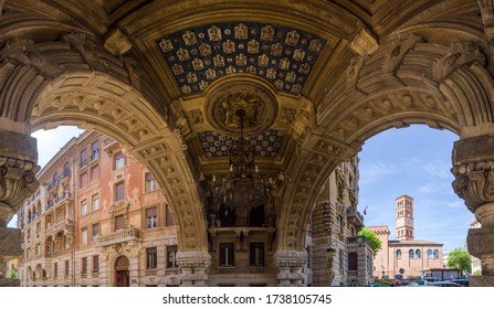 Panoramic composite of arch gallery ceiling, with stone carvings and painted patterns in Quartiere Coppedè, a 20th century Liberty Style architecture district in Rome, Italy