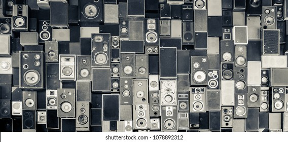 Panoramic detail view of speakers hanging on the wall in monochrome vintage style