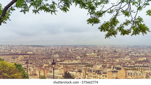 Panoramic distant scene of Paris skyline and urban and industrial areas