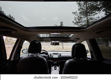 Panoramic double sunroof  in the interior of the car.