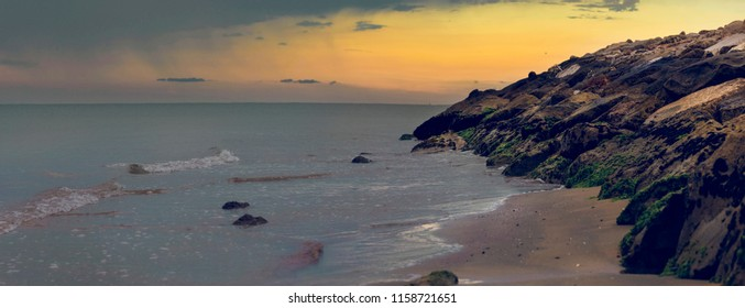 Panoramic early morning view of an empty beach with rocks in Bibione, a town on the Adriatic Sea