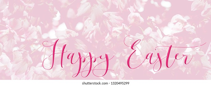 panoramic Easter background banner with pretty pink blossom, and 'Happy Easter' quote. Perfect for Easter Social Media campaigns.