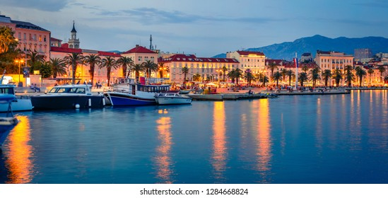 Panoramic evening cityscape of Split town. Splendid summer sunset in Croatia, Europe. Beautiful world of Mediterranean countries. Traveling concept background.