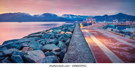 Panoramic evening view of Villasimius port. Great summer sunset on Sardinia island, Italy, Europe. Cololrful seascape of Mediterranean sea. Traveling concept background.