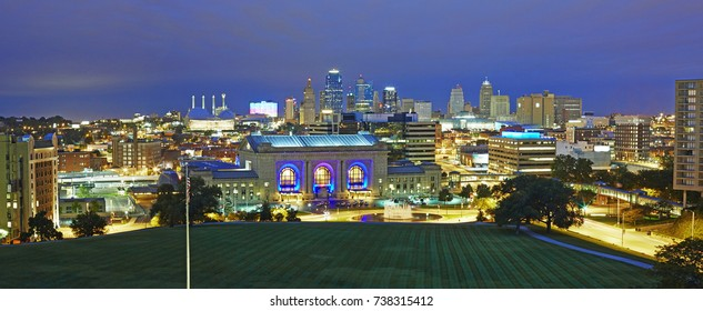 Panoramic format and facade of the 'Union Station' Kansas City MO illuminated at night. Opened in 1914 the refurbished station boasts theatres, museums and attractions