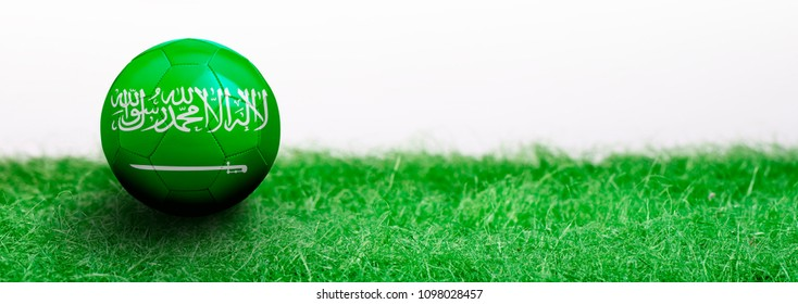 Panoramic Green grass isolated on white background and flagged soccer ball. Saudi Arabia