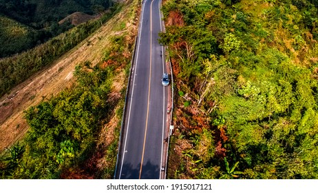 Panoramic high angle background Of nature scenery, surrounded by mountains, trees, fields, and blurred wind blowing cool during the trip