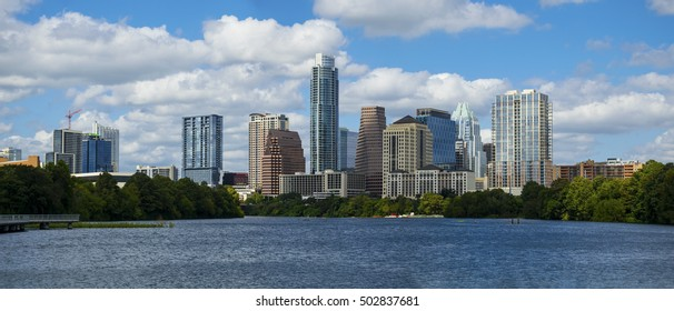Panoramic High Detail Austin Texas Skyline Cityscape from the Riverside pedestrian Bridge on the Colorado River or Town Lake Summer Time Bliss