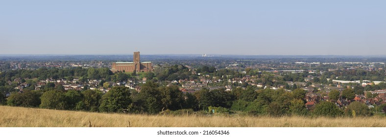 A panoramic high view of Guildford showing the cathedral, residential and industrial areas. 13253 x 4372 image.