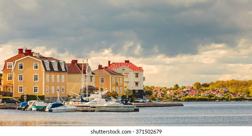 Panoramic image of ancient houses with boats in the seaside bay of Karlskrona, Sweden
