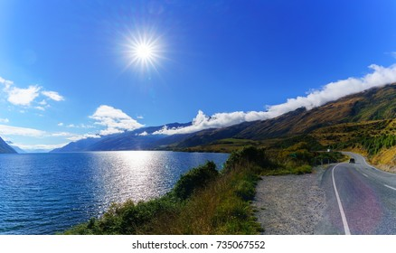 Panoramic image of beautiful backlit of Lake Wakatipu , South Island of New Zealand