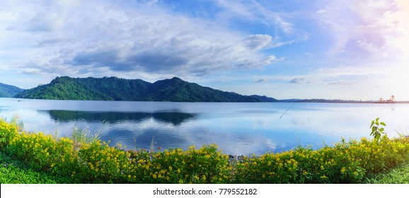 Panoramic image of beautiful Khun Dan Prakarn Chon Dam with reflection , the largest and longest roller compacted concrete (RCC) dam in the world , Nakhon Nayok , Thailand