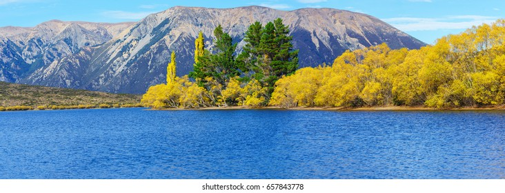 Panoramic image of beautiful Lake Pearson (Moana Rua) in Autumn , Arthur's pass National Park , South Island of New Zealand