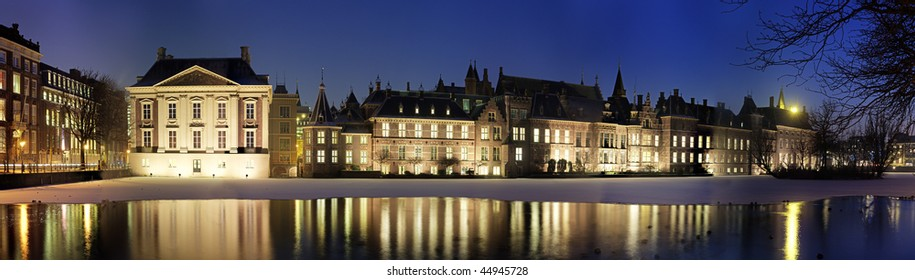 Panoramic image of The Binnenhof and the Mauritshuis, seen from across the Hofvijver in Den Haag, The Netherlands on a cold winter night.