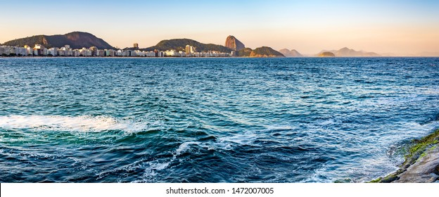 Panoramic image of Copacabana beach and Sugar Loaf in the background during late afternoon in Rio de Janeiro