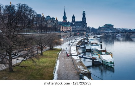 Panoramic image of Dresden, Germany during et the winter evening with Elbe River in the foreground.