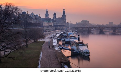 Panoramic image of Dresden, Germany during sunset with Elbe River in the foreground.