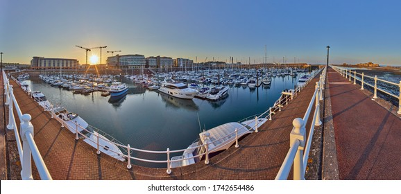 Panoramic image of Elizabeth Marina, St Helier early morning from the West marina wall with the entrance and Elizabeth Castle on the right hand side of the image. Jersey, Channel Islands, UK
