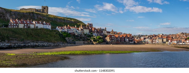 Panoramic image of historic Whitby Harbour and St Mary's church across tate hill sands, North Yorkshire, England.