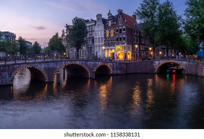 Panoramic image of the Keisersgracht Canal in the heart of Amsterdam. Old homes are visible on the opposite bank of the canal.