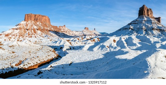 A Panoramic image of the mesas and towers in Castle Valley on a snowy day near Moab, Utah.