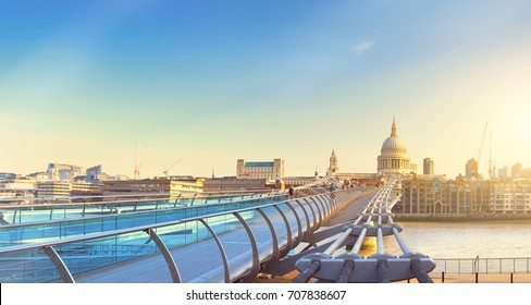 Panoramic image of Millennium bridge and St. Paul's cathedral across river Thames in the morning in London, UK. Toned panoramic image.