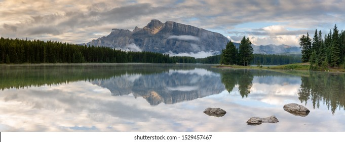 Panoramic image of Mount Rundle reflecting in Two Jack Lake with early morning mood, Banff National Park, Alberta, Canada