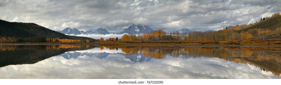 Panoramic image of Mt Moran on a fall morning relected on the Sanke river's Oxbow Bend, Panoramic image of Mt Moran on a fall morning relected on the Snake river's Oxbow Bend