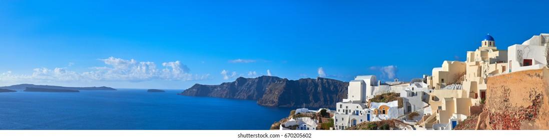 Panoramic image of Oia village, Santorini island, Greece, with local church