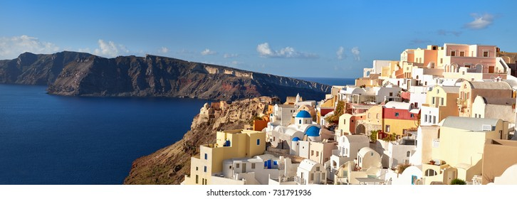 Panoramic image of Oia village, Santorini island, Greece, with local church and traditional appartments on a bright day