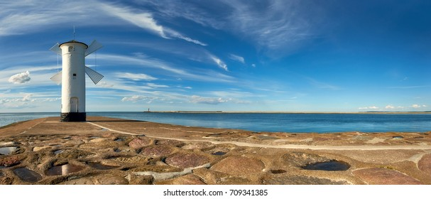 Panoramic image of an old lighthouse in Swinoujscie, a port in Poland  on the Baltic Sea. The lighthouse was designed as a traditional windmill.