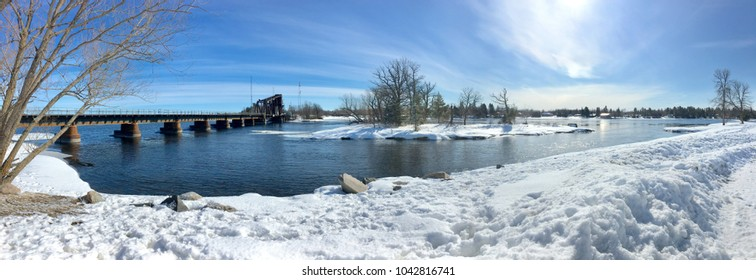 Panoramic Image of the Railroad Tracks Crossing Over Rainy River