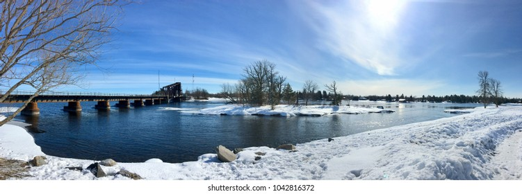 Panoramic Image of Rainy River. Looking at the Railroad Tracks