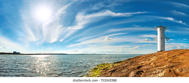 Panoramic image of a seaside by lighthouse in Swinoujscie, a port in Poland on the Baltic Sea.