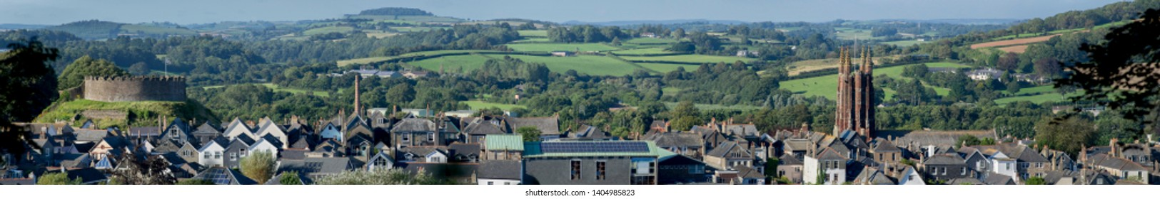 A panoramic image shows the town of Totnes, Devon, with its castle and church