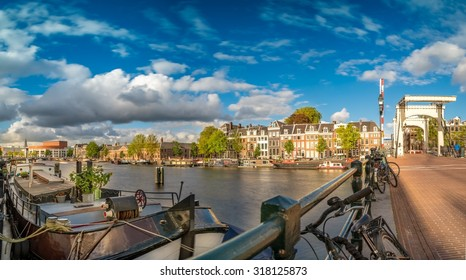 Panoramic image of Skinny Bridge (Dutch: Magere Brug) over the Amstel in Amsterdam, Netherlands.